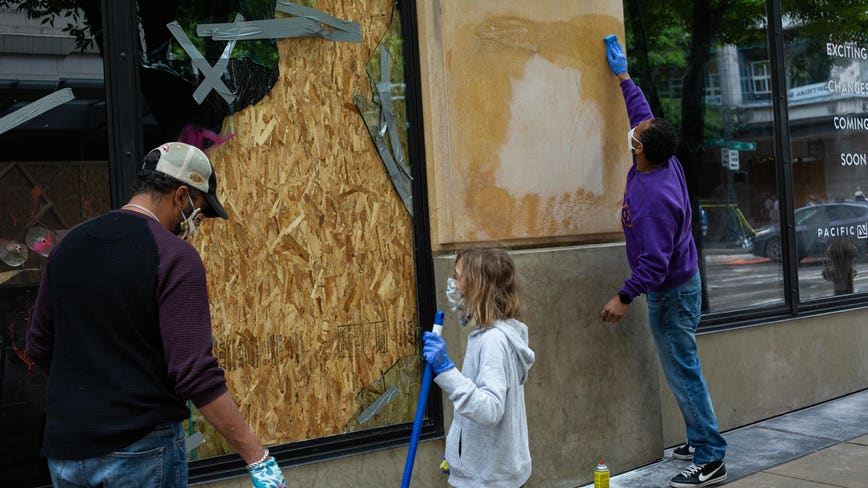 Volunteers across the US gather to clean up debris, trash and graffiti after protests