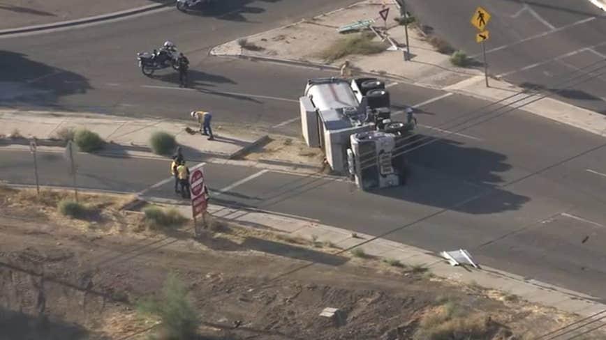FD: Hazmat crews respond to semi-truck rollover, natural gas leak in Phoenix