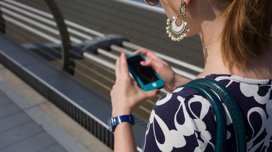 UK - London - Girl using her smartfone
