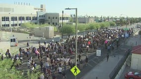 Hundreds take the streets of downtown Phoenix for a 17th consecutive day of protests