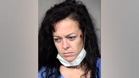 Peoria Police: Woman arrested after running over officer with car