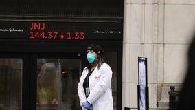 Dow sinks 1,800 as virus cases rise, deflating optimism