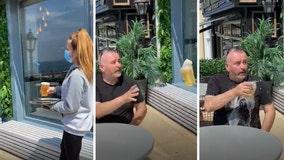 Restaurant server tosses open beer to customer in effort to maintain social distancing