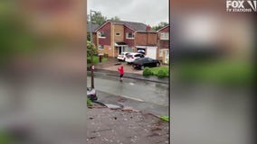 Neighbors start 'singin' in the rain' with socially distanced dance party