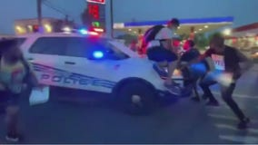 Video shows Detroit police cruiser driving through demonstrators after being surrounded during protests