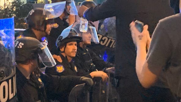 Phoenix Police officers take a knee with George Floyd protesters