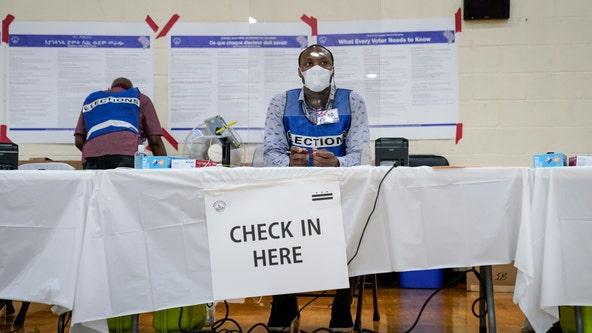 Curfews, pandemic test voters in primaries held amid unrest