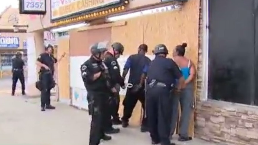 Good Samaritans detained on live TV while protecting LA business from alleged looters