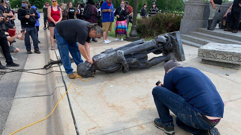 Columbus statue down