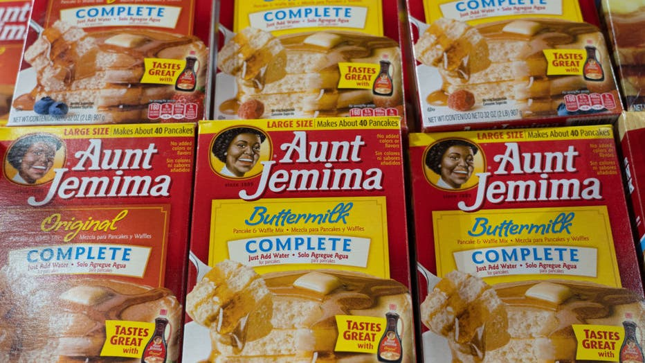 Aunt Jemima products seen displayed on supermarket shelves.