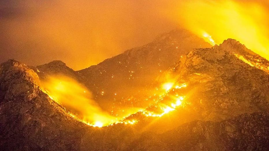 Mountain on fire at night