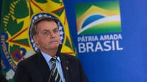 Brazil's Bolsonaro says he will be tested for COVID-19