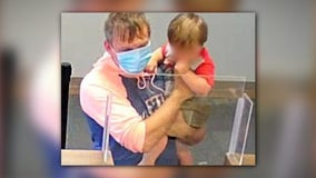 Police arrest man accused of robbing Ohio credit union while holding toddler