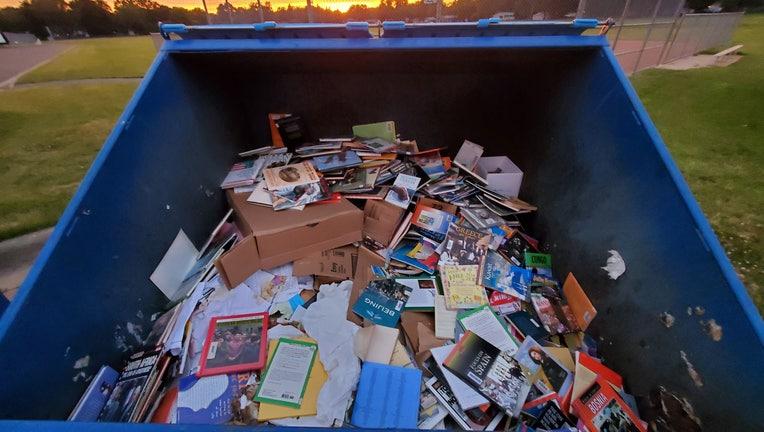 books in dumpster 3