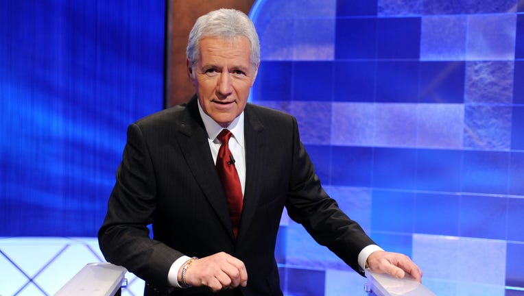 Game show host Alex Trebek poses on the set of the