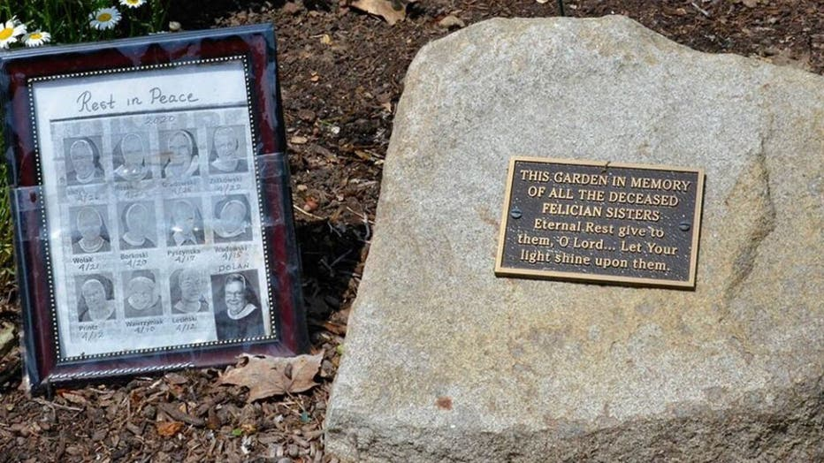 A-small-memorial-to-the-12-sisters-who-died-in-one-month-from-COVID-19-sits-in-the-gardens-outside-the-Felician-Sisters-convent-in-Livonia-Mich..jpg