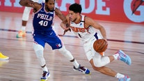 Booker's 35 points help streaking Suns beat 76ers 130-117, only undefeated team in NBA bubble