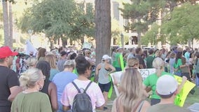 Parents rally for a choice to send kids back to school, saying online class 'isn't sufficient'