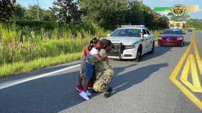 Florida deputies stage fake traffic stop to surprise kids with military mom's homecoming