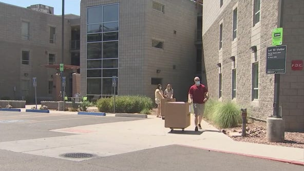 Pull up, drop off and then get out for ASU students who are moving into dorms