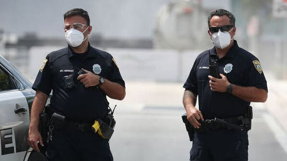 Florida sheriff bans deputies from wearing face masks, report says