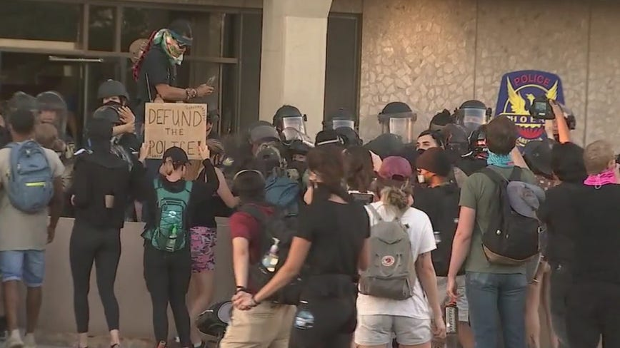 Protesters march in downtown Phoenix on anniversary of Michael Brown's death, 8 arrested