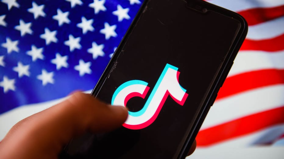 In this photo illustration, a TikTok logo is displayed on a