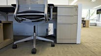 Desk shortage forces people to get creative about workspaces