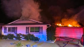 Firefighters battle double house fire in Scottsdale
