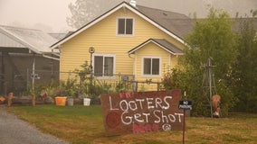Oregon drivers stopped at gunpoint by groups protecting wildfire ravaged properties from looters