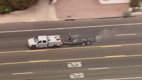 Police pursuit ends with standoff on PCH in Malibu