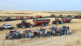 Neighbors harvest farmer's crops for him after he suffered heart attack in his field