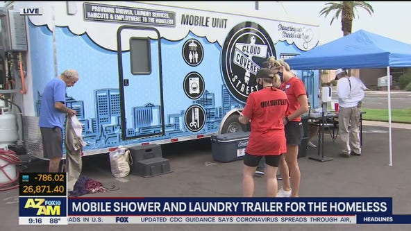 Mobile shower and laundry trailer for homeless