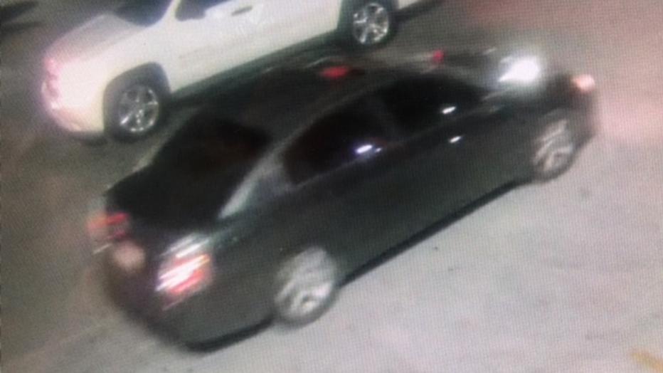 Dark-colored suspect vehicle