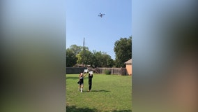 Couple tests socially-distanced Halloween candy delivery system using drone