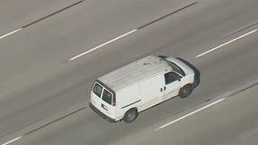 Police pursuit ends after driver surrenders, cargo van rolls down street