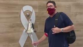 Washington Football Team Coach Ron Rivera rings bell after final cancer treatment