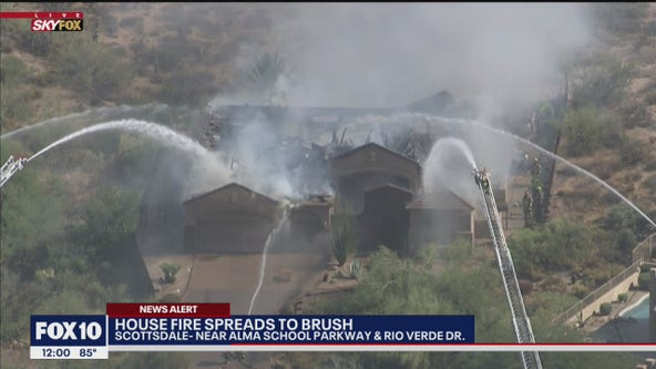 Firefighters battle house fire in North Scottsdale