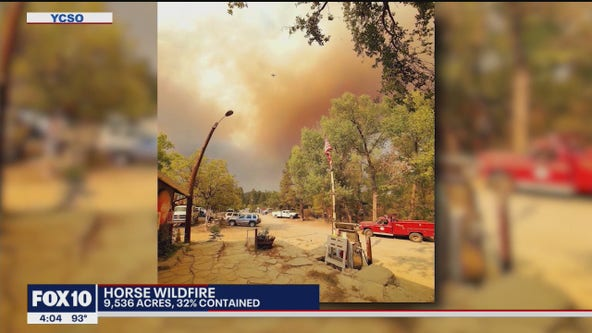 Mandatory evacuations remain in effect as crews continue to battle the House Fire