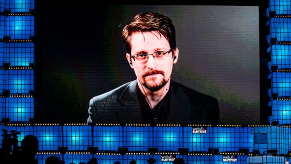 Edward Snowden is granted permanent residency in Russia