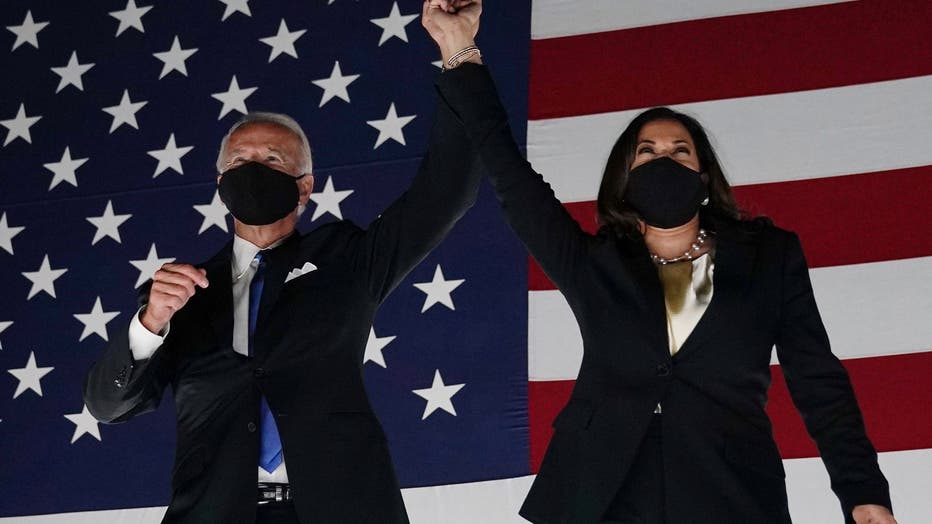 Former vice-president and Democratic presidential nominee Joe Biden (L) and Senator from California and Democratic vice presidential nominee Kamala Harris greet supporters outside the Chase Center in Wilmington, Delaware, at the conclusion of the Democratic National Convention, held virtually amid the novel coronavirus pandemic, on August 20, 2020.