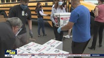 Volunteers pack school bus with Thanksgiving food donations in Mesa
