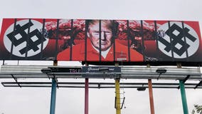 New billboard in downtown Phoenix shows Trump behind bars in prison jumpsuit