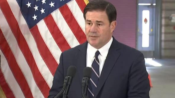 Gov. Doug Ducey signs mail-in ballot signature bill amid protest over voting rights