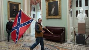FBI: Delaware man seen holding confederate flag during Capitol riot surrenders