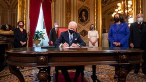Biden signs executive orders on COVID-19, immigration, rejoining Paris climate accord and WHO