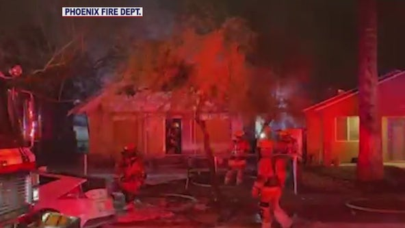 Dozens of firefighters battle Phoenix house fire