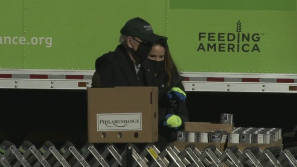 Biden spends MLK Day of Service assembling food boxes at Philabundance