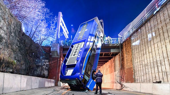 Bus careens off road, dangles from Bronx overpass injuring 8