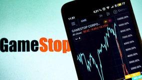 Tech stocks slide as bond yields spike, GameStop soars